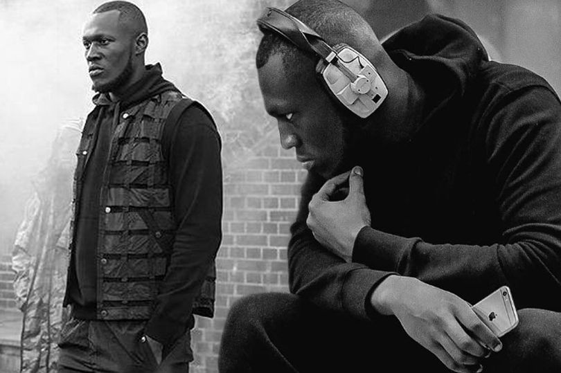 Grime star went viral after waking up to find POLICE kicking down his door.