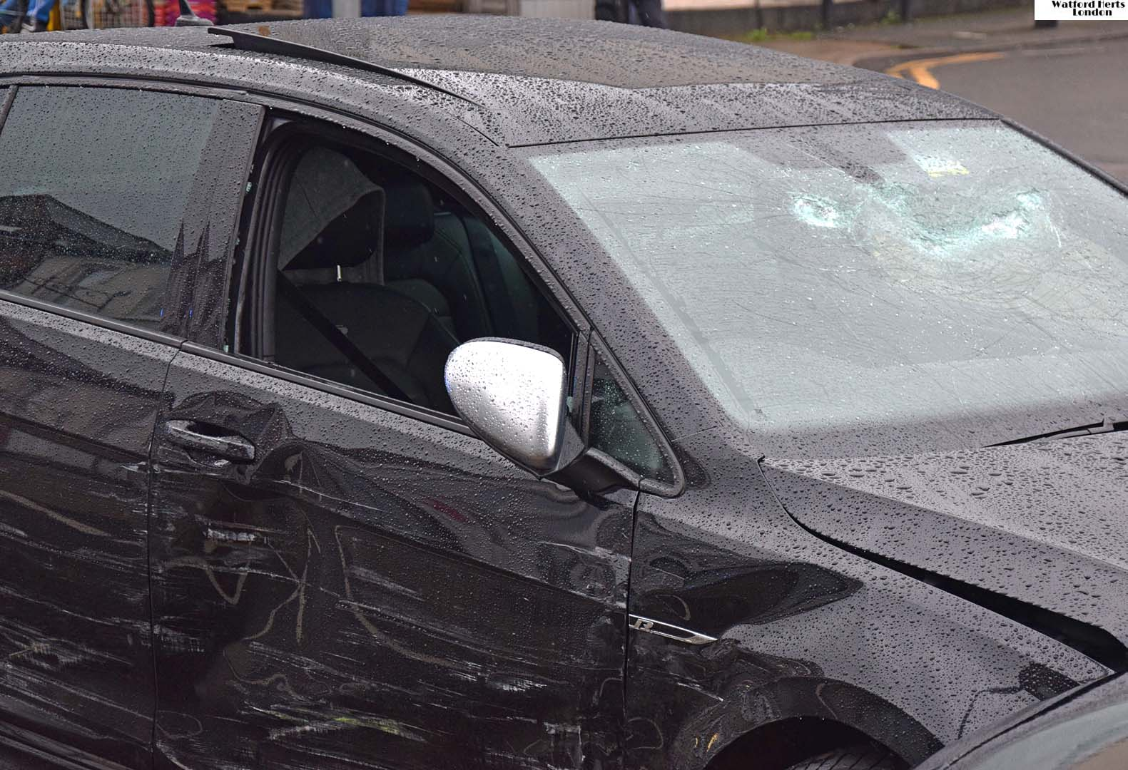 Car screen smashed collision police scrapes paint