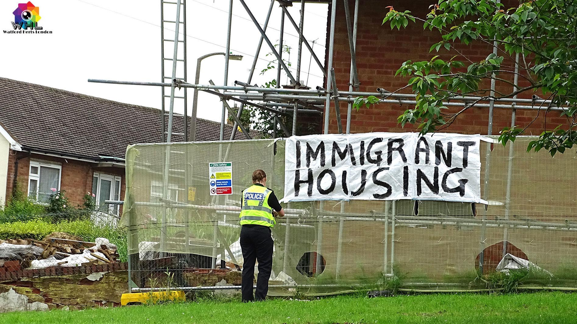 Police Remove Immigrant Housing Graffiti Banner on House in Meriden Watford 2016