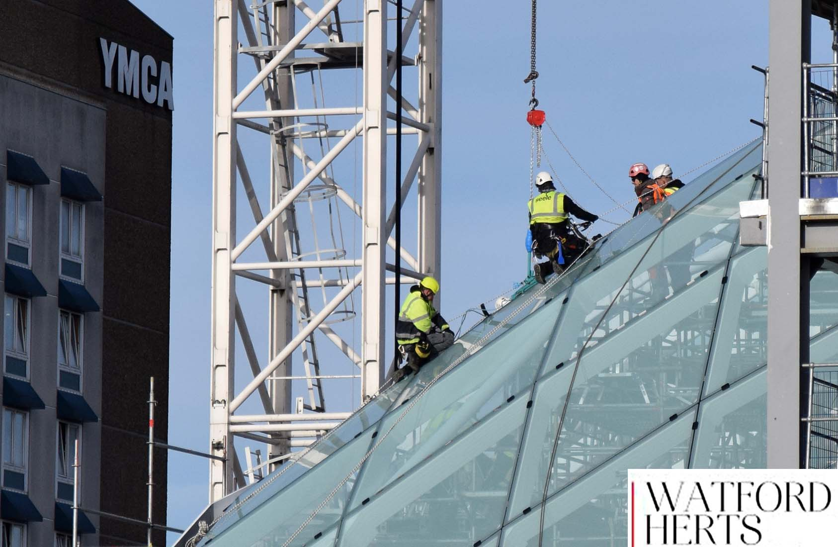 Workmen on top of Glass Roof of Watford Shopping Centre Construction